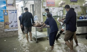 A coronavirus patient arrived for admission at a flooded hospital during tidal floods in Chittagong, India.