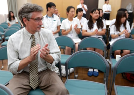 Clifton Truman Daniel claps during a meeting with students at Hiroshima Jyogakuin women's junior and senior high school in Hiroshima in 2012. Daniel was invited by a Japanese peace group and attended a memorial event.