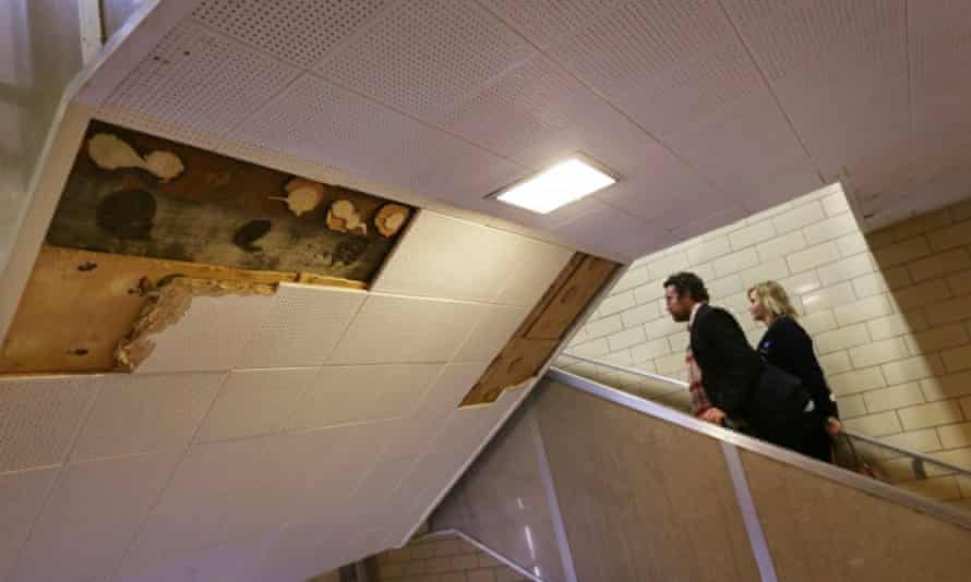 American Federation of Teachers representatives walk by some missing ceiling tiles while touring Osborn high school in Detroit in January.
