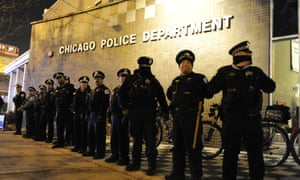 Chicago police officers line up outside the District 1 central headquarters Tuesday in Chicago, during a protest for 17-year-old Laquan McDonald.