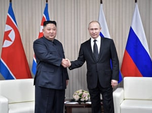 Putin meets Kim with the first of many handshakes for the camera