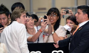 YouTube star PewDiePie (Felix Kjellberg) poses for a selfie with a fan in Singapore.