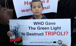 A protester demands an end to Haftar's offensive against Tripoli, 12 April.
