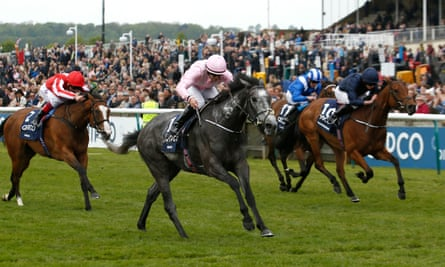 Winter, ridden by Wayne Lordan, wins the Qipco 1,000 Guineas from Rhododendron, finishing late on the far side, and Daban