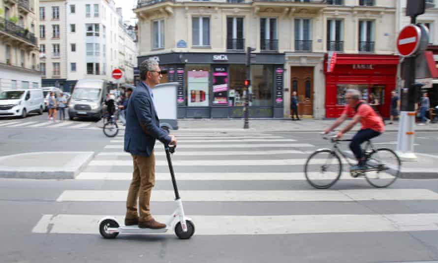 An e-scooter rider on Rue de Rivoli