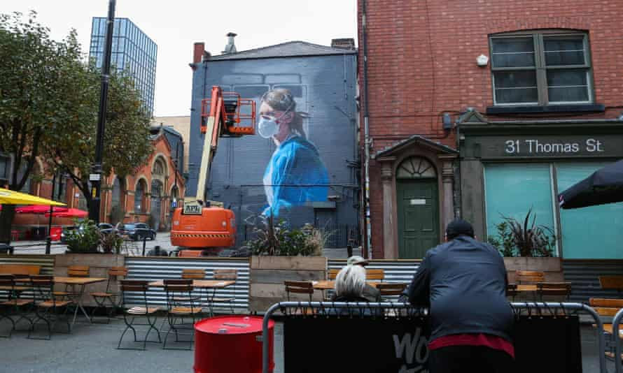 A new mural in Manchester depicts an NHS worker, seen from a bar in the Northern Quarter.