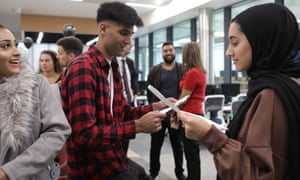 Pupils collect their results in Rochdale this week.