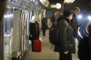 London, UK Commuters wait on a London Underground station platform as Britons were told life may not return to normal for six months or longer as it battles the coronavirus outbreak