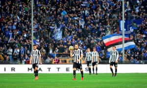 The Juventus players look dejected as Sampdoria's fans celebrate the opening goal, but things quickly got worse for the champions.