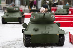 Moscow, Russia: children, each accompanied by an adult, drive models of the Soviet-era T-34 tank at the Tankodrom children's adventure attraction in Sokolniki park