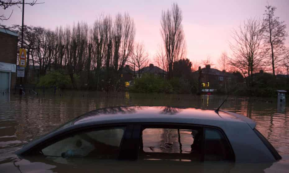 A car is left submerged after the River Foss burst its banks in Yorkshire.
