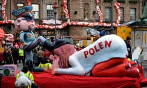 A carnival float depicting the chairman of the Law and Justice party, Jarosław Kaczyński, oppressing Poland.