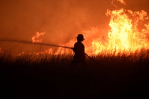 Firefighter hosing down flames in Seiling, Oklahoma