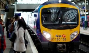 Passengers wait for the TransPennine Express service between Manchester and Leeds.