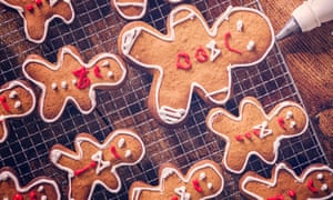 Decorating Christmas gingerbread cookies with colourful icing