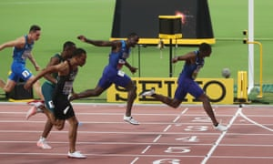Christian Coleman crosses the line to win the final ahead of second placed Justin Gatlin and third placed Andre De Grasse.