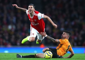 Wolves Ruben Neves takes down Arsenal's Dani Ceballos during the 1-1 draw at the Emirates stadium.