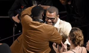 Daniel Kaluuya, left, congratulates Jordan Peele, winner of the Oscar for best original screenplay.