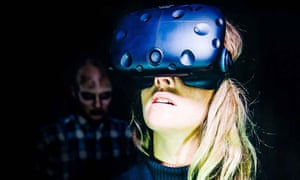 a woman wearing a headset for immersive theatre piece virtually dead