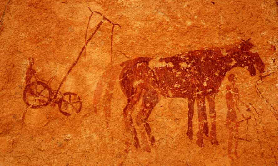 Rock painting in Tassili Maghidet, Libya, showing a plough and horses.