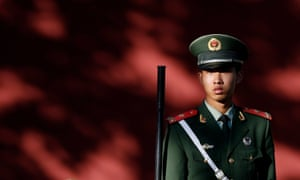A paramilitary officer guards along the wall at Tiananmen Square in Beijing, China. Dong Guangping was detained after participating in a peaceful event commemorating victims of the 1989 crackdown.