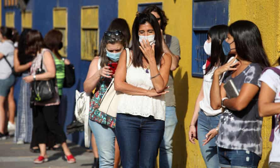 People queue for coronavirus vaccinations at the Atlanta soccer club in Buenos Aires, Argentina.
