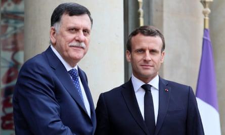 Fayez al-Sarraj (L) meets Emmanuel Macron in Paris