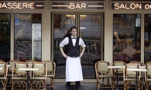 A Paris waiter waits for customers outside his restaurant, Paris, France.