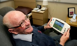 Patient Gerald Hicks trying out some of the technology involved in Surrey and Borders NHS Trust's trial.