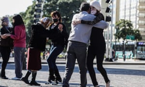 """Milonga -folkloric musical genre similar to tango- dancers perform during a protest under the slogan """"In defense of the hug and tango as a recreational activity in public spaces"""" next to the obelisk in Buenos Aire amid quarantine measures imposed in the face of the Covid-19 pandemic."""
