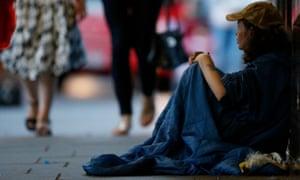 Homeless woman on street, London