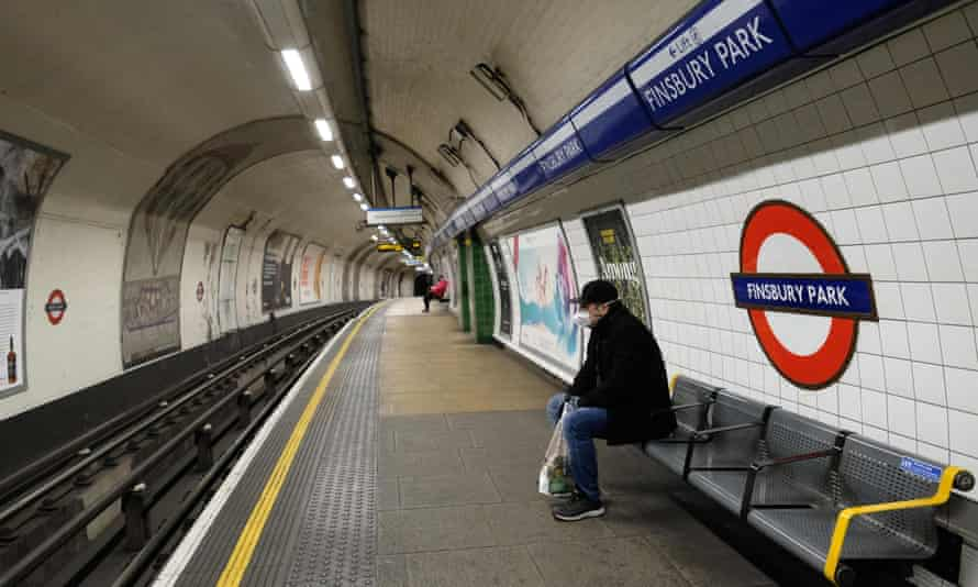 A man waits for a train to arrive on at Finsbury Park underground station in London on 31 March, during the first lockdown.
