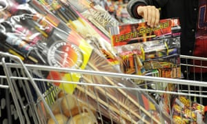 A supermarket trolley stacked with fireworks.