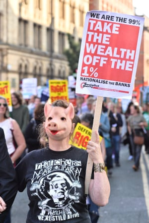 A protester with a nationalise the banks placard