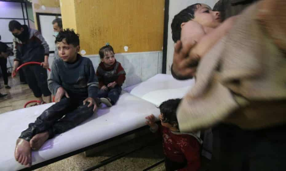 Affected children wait to receive medical treatment after a poisonous gas attack.