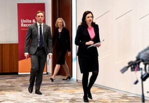 Queensland premier Annastacia Palaszczuk (right), deputy premier Steven Miles and Queensland chief health officer Dr Jeanette Young (back) arrive at a press conference to give an update on the state's Covid-19 border controls.