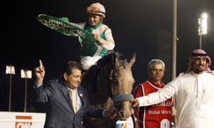 Arrogate and Mike Smith after winning the Dubai World Cup.