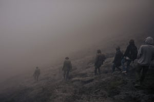The volcanologists and rangers climb back down the slopes