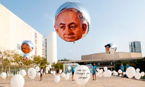 Balloons bearing the face of Benjamin Netanyahu in an installation in Tel Aviv that symbolises broken promises made by the Israeli prime minister.