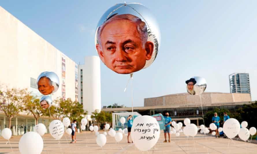 Balloons bearing the face of Benjamin Netanyahu in an installation in Tel Aviv that symbolises broken promises made by the Israeli prime minister.