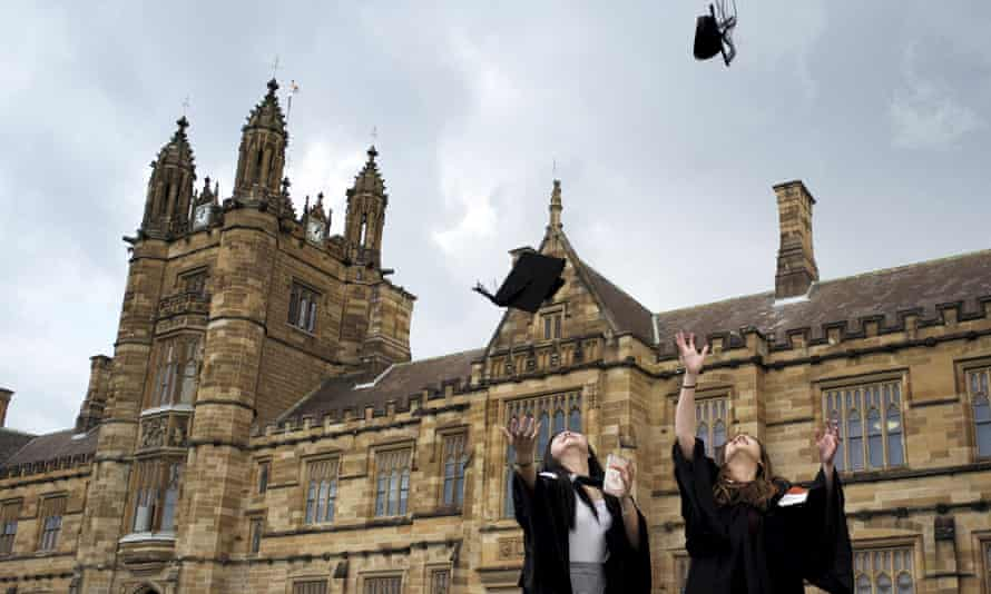 University of Sydney students toss their graduation hats into the air. Under changes to Hecs repayments, anybody earning over $45,881 a year will now have to start paying off their student loans.