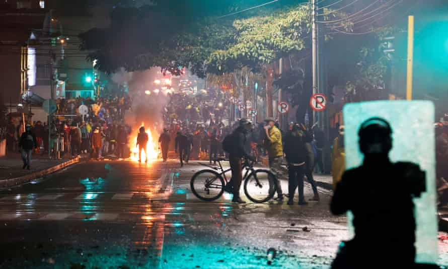 Demonstrators confront police in Bogotá as protests over tax reform entered a fourth day on Saturday.