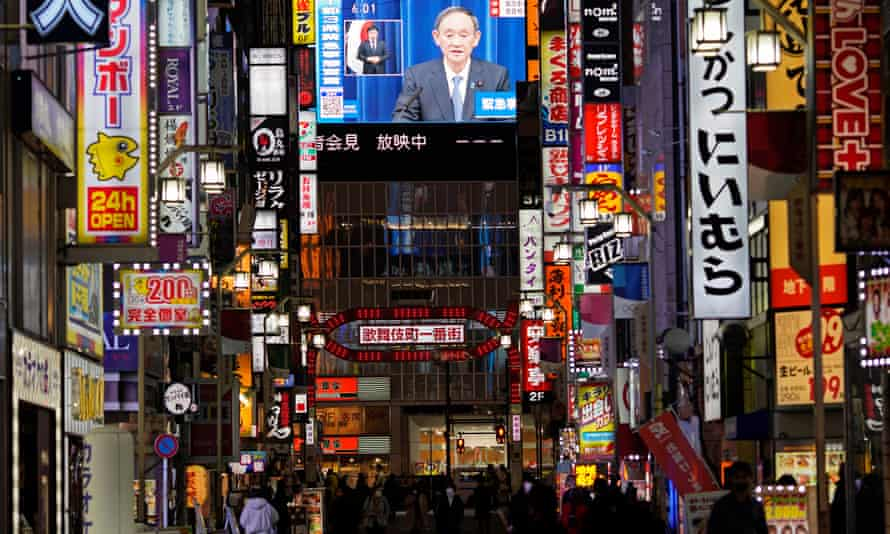 Prime Minister Yoshihide Suga announces a state of emergency during a televised news conference in Tokyo's biggest entertainment district Kabukicho, Japan, 7 January 2021.