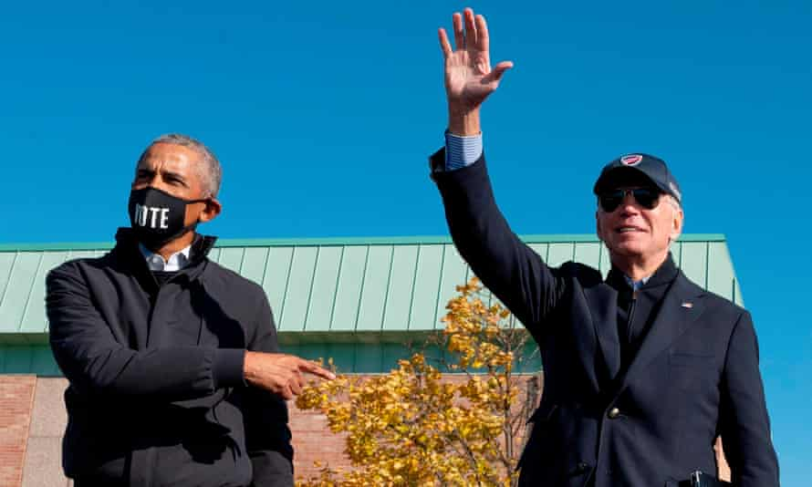 Obama and Biden in Flint on Saturday. Obama said: 'With Joe and Kamala at the helm, you're not going to have to think about them every day.'