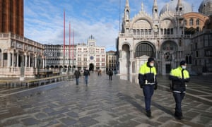 Police officers walk in St. Mark's square on the day that Venice Carnival was due to begin, with the annual event cancelled due to coronavirus disease precautions, in Venice, Italy, January 31, 2021.