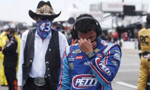 Bubba Wallace, right, is overcome with emotion as he and team owner Richard Petty walk to his car in the pits of the Talladega Superspeedway on Monday