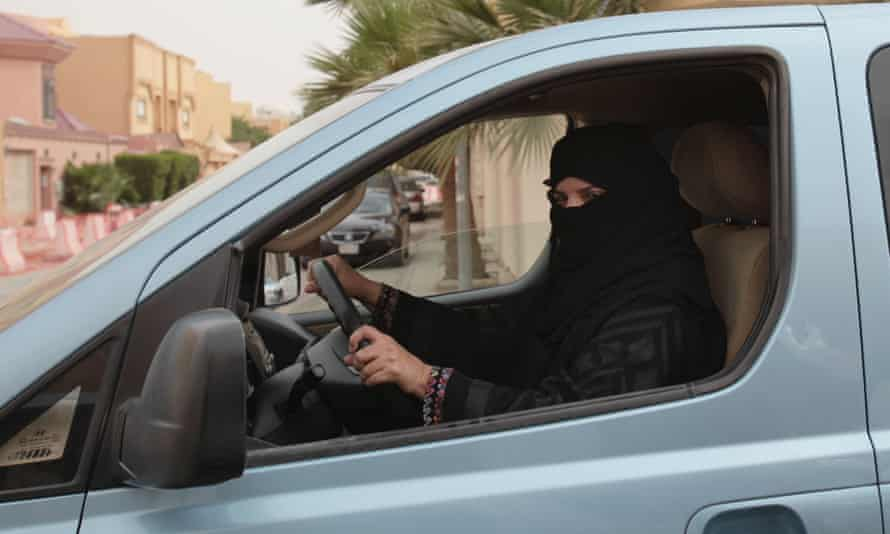 A woman drives a car in Riyadh, Saudi Arabia in 2013 as part of a campaign to defy Saudi Arabia's ban on women driving.
