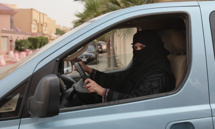 A woman drives a car in Riyadh, Saudi Arabia in 2013 as part of a campaign to defy Saudi Arabia's ban on women driving.