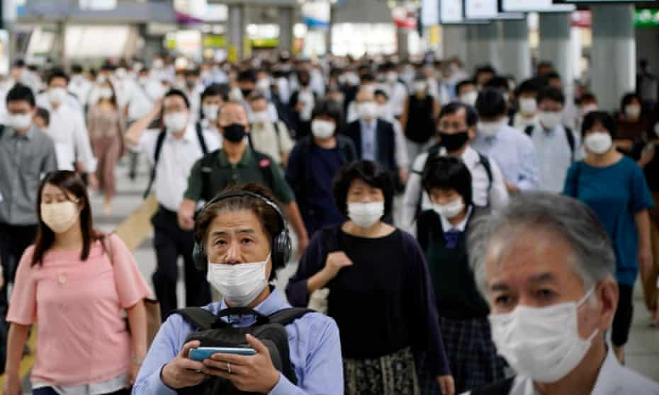 Commuters on their way to work at Shinagawa station in Tokyo