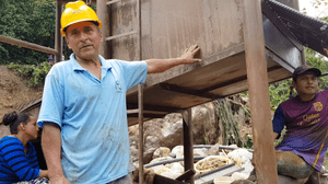 """""""Joselito"""" and two of the other miners at the new site discovered by the A'I Cofan. Joselito identified the woman behind him as the """"boss."""""""